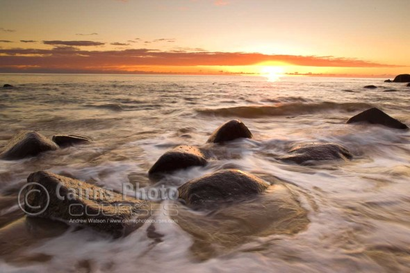 Image of sun rising over the Coral Sea, Pebbly Beach, North Queensland, Australia