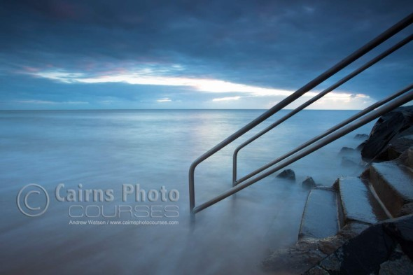 Image of sea mist rolling over coastal steps, Cairns, North Queensland, Australia