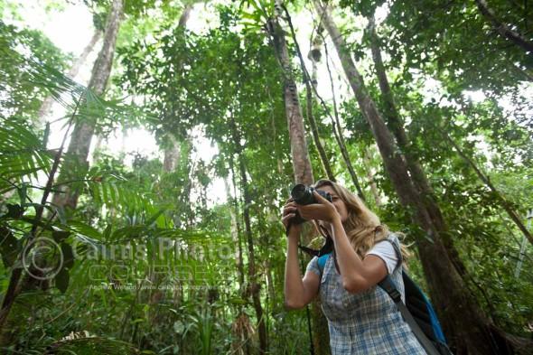 Woman taking a photo in rainforest, Mossman Gorge, North Queensland, Australia