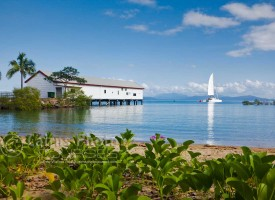Image of sailing boat passing Sugar Wharf, Port Douglas, North Queensland, Australia