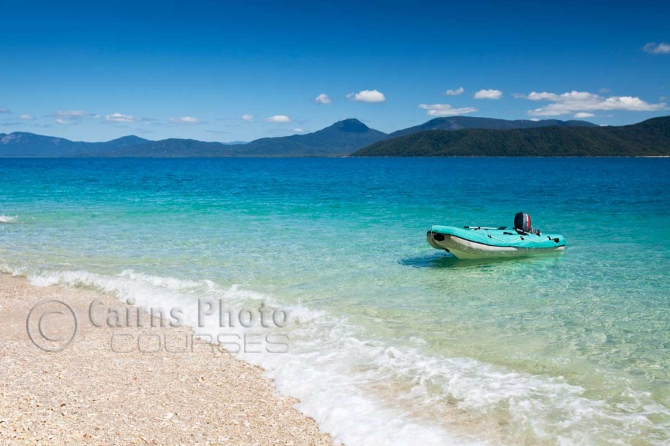 Image of zodiac floating in clear waters of Nudey Beach on Fitzroy Island, Cairns, North Queensland, Australia
