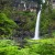 Image of Nandroya Falls surrounded by tropical ferns, Atherton Tablelands, North Queensland, Australia