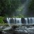 Image of sunlight illuminating Nandroya Falls, Atherton Tablelands, North Queensland, Australia