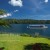 Image of tour boat crossing scenic Lake Barrine, Atherton Tablelands, North Queensland, Australia