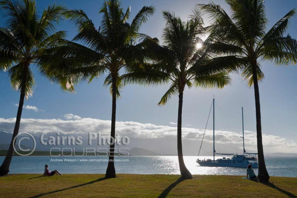 Image of sailboat returning to port at sunset, Port Douglas, North Queensland, Australia