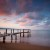 Image of wooden jetty extending into Coral Sea, Cairns, North Queensland, Australia