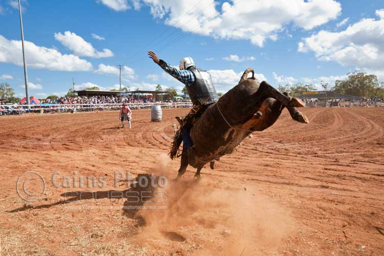 Bull rider in action.  Canon 16-35mm lens @ 24mm, f8 @ 1/500 sec, ISO 400