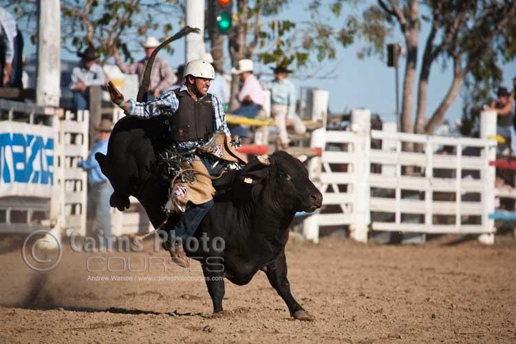 Bull rider holding on.  Canon 100-400mm lens @ 400mm, f5.6 @ 1/1250 sec, ISO 400