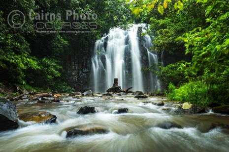 Waterfall in tropical rainforest surrounds